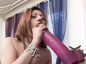 Dildo Slut Slides A Big One Into Her Wet Cunt